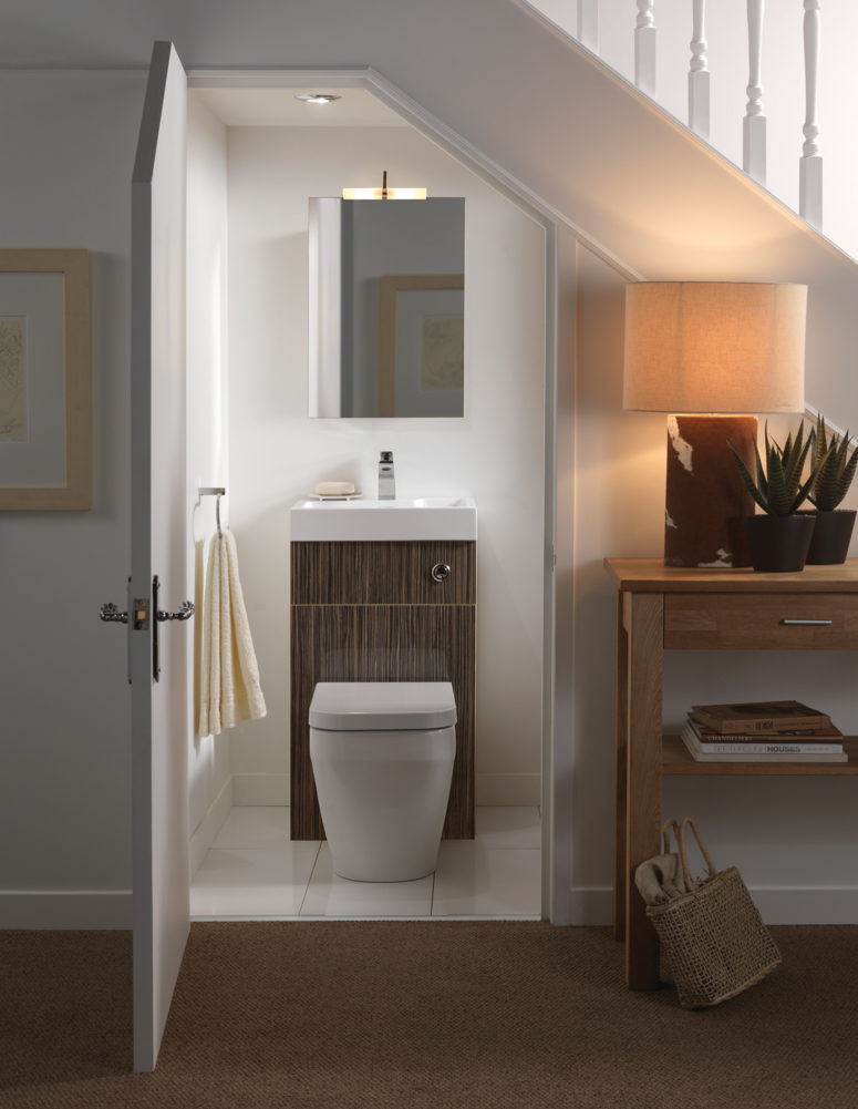 Did you know you could turn an under stairs space into a small bathroom? Just install a cute toilet sink combo and add a mirror above it.