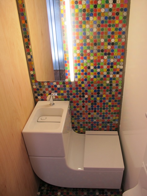 A combo unit plus an accent wall made of recycled bottle caps is definitely a good looking solution for a tiny space.