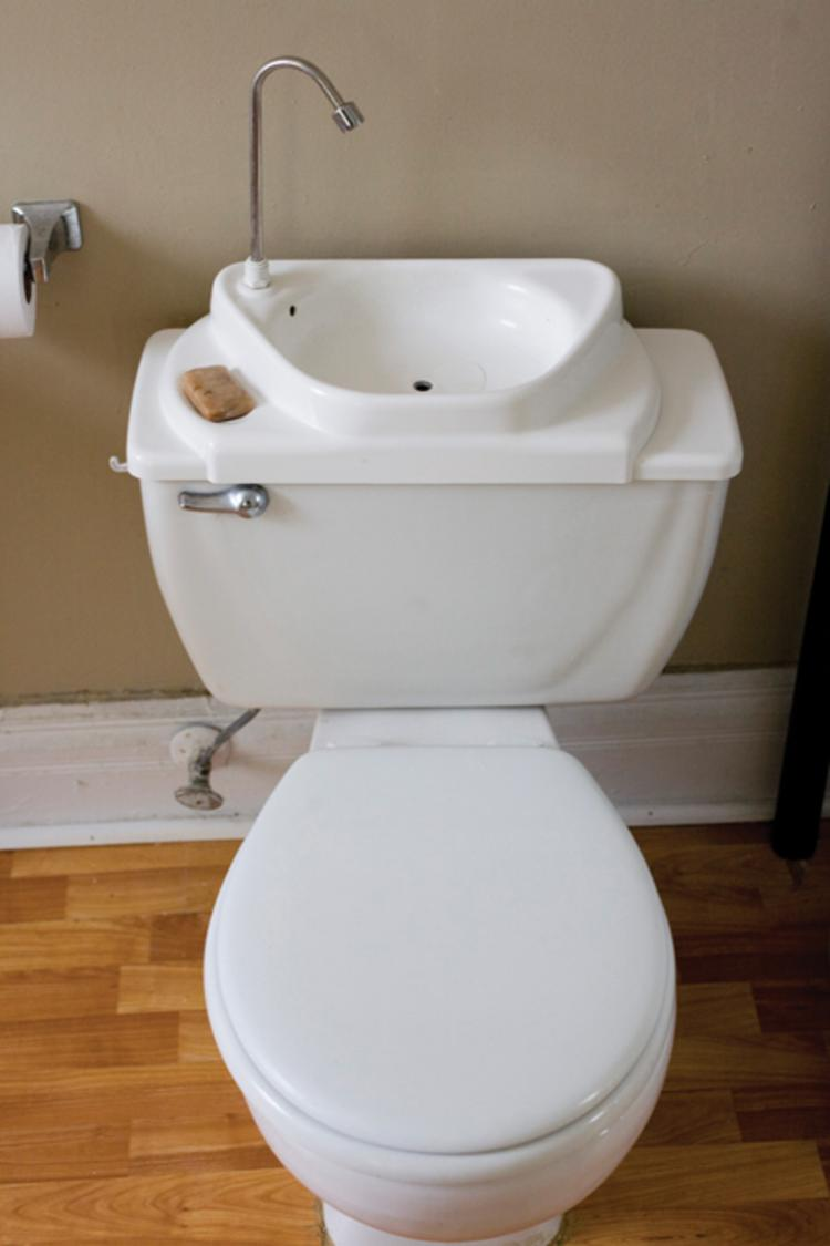 Nowadays you can buy a kit to replace a toilet's reservoir lid with a sink that activates when flushed. It's a great water-saving solution.