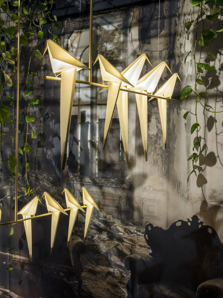 Perch Light Family lamps and chandliers are shaped as origami birds
