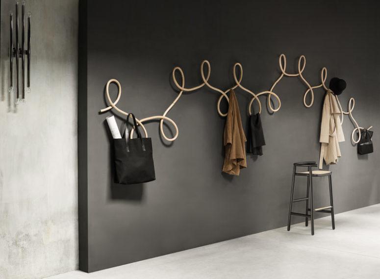 Sculptural coat rack inspired by waltz dancing digsdigs for Designer coat hooks