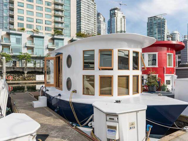 This floating house is styled like a real boat both inside and outside