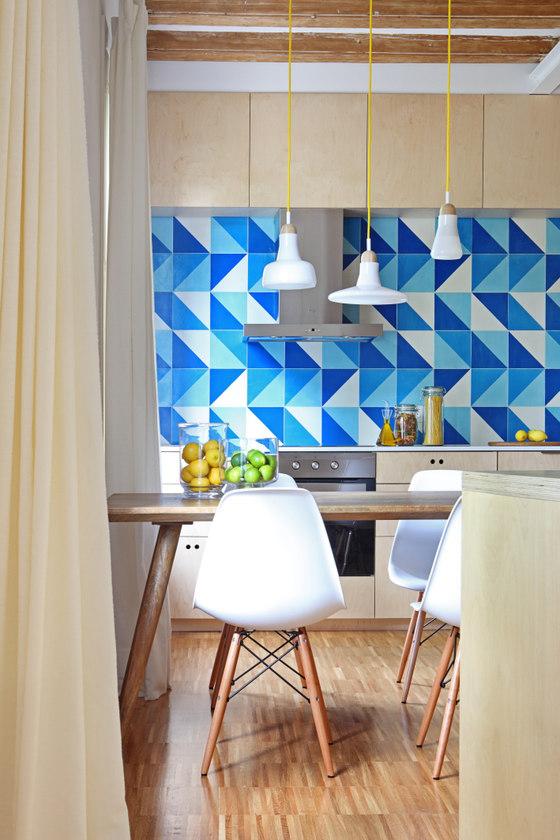 Blue tiles in several colors comprise a cool kitchen backsplash