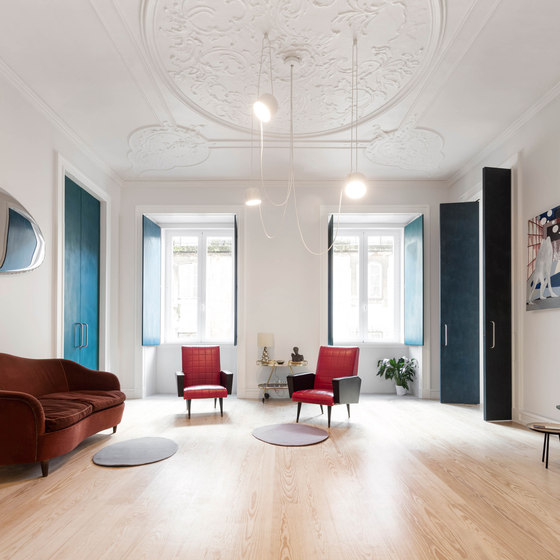 Old plaster ceilings with all the structural elements were preserved to add a refined touch