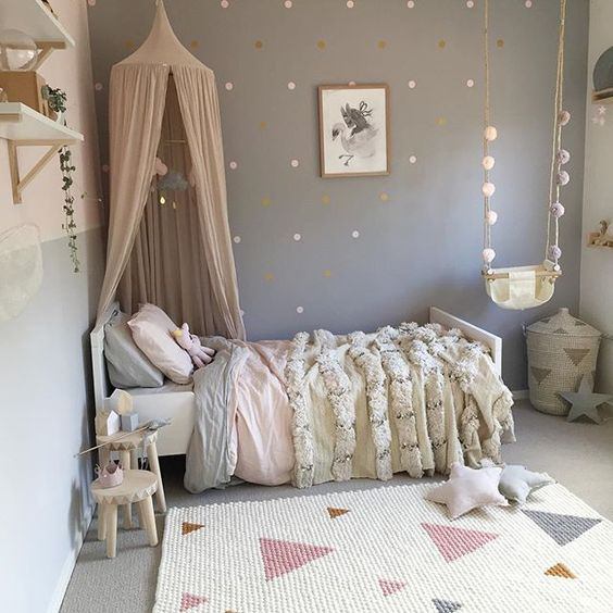 Pastel girl's sleeping area with a canopy over the bed