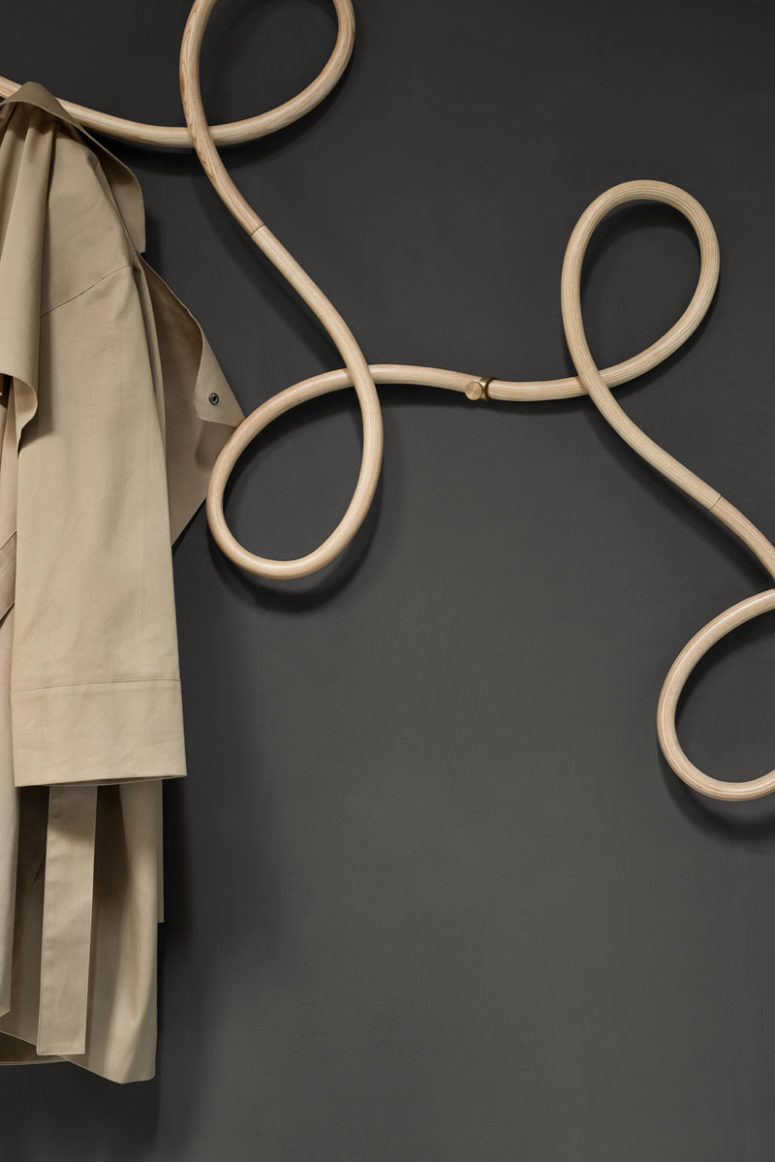 The loops are created by steaming and bending rounded lengths of wood