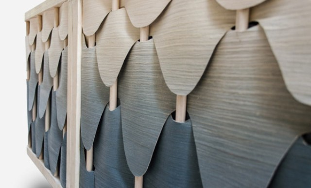 The prominent feature of the piece is the layered doors made of ash veneer