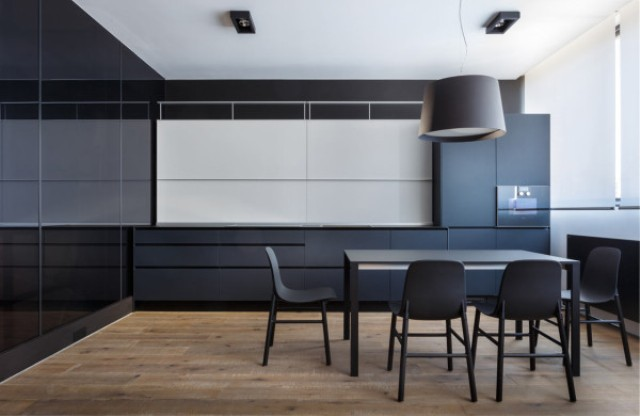 The sleek kitchen is uncluttered and minimalist, here you'll have to guess where everything is