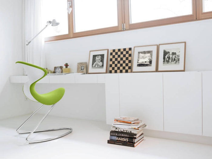 This white study nook by the window is enlivened with the help of just one lime green Oyo chair