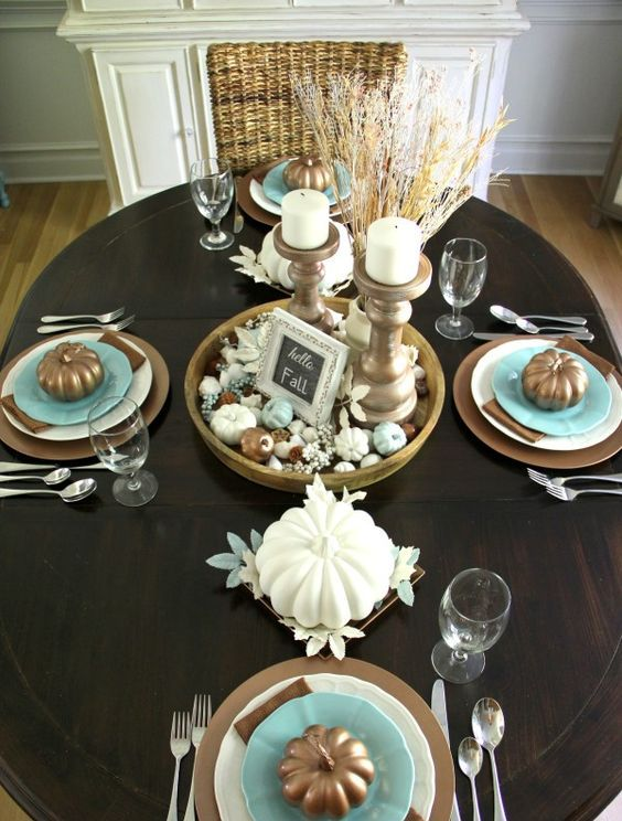 brown tablescape with blue accents, candles in antique candle holders and wheat