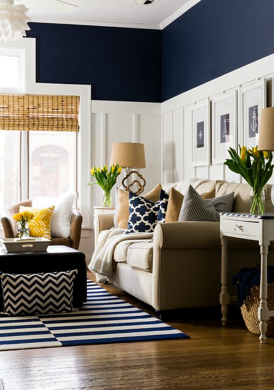 navy living room with tall white wainscoting