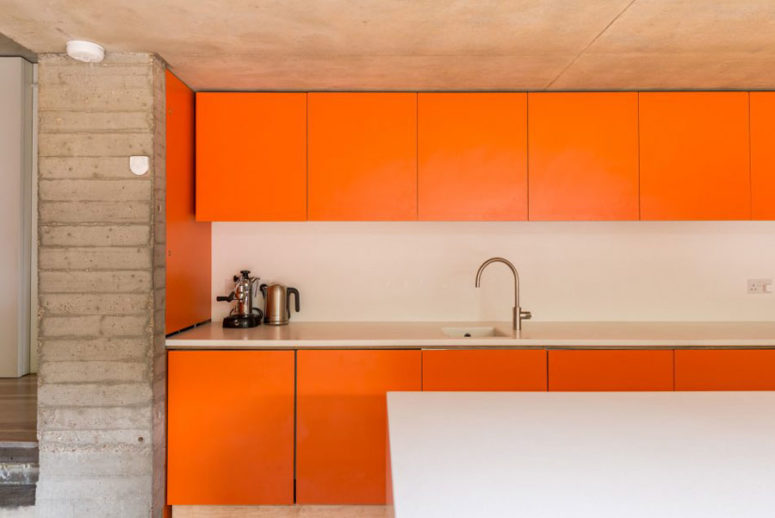 Industrial man 39 s cave with bold orange touches digsdigs for Nice colours for kitchen walls