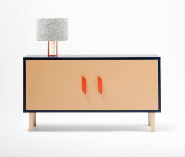 The sideboard is available in light-colored wood wrapped with a navy surface