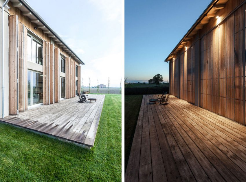 The wooden deck and perfectly manicured lawn extend living spaces, providing opportunities for spending time outdoors