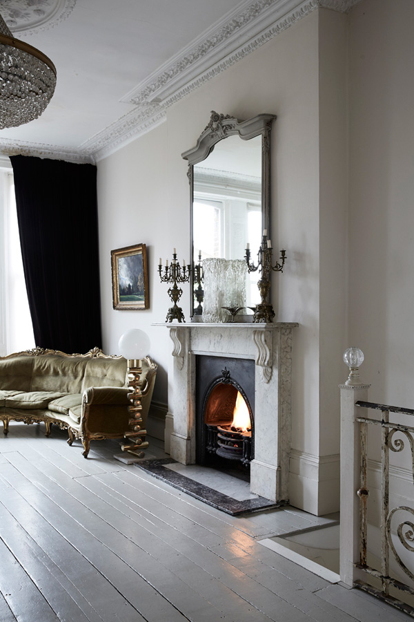 White and cream decor in various rooms create a perfect backdrop for vintage furniture