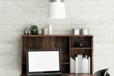 03 a wall-mounted desk of reclaimed wood accomodates a laptop