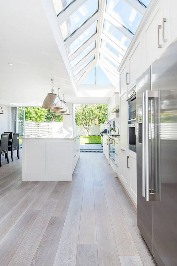 brushed oak floors create an airy feeling in the space