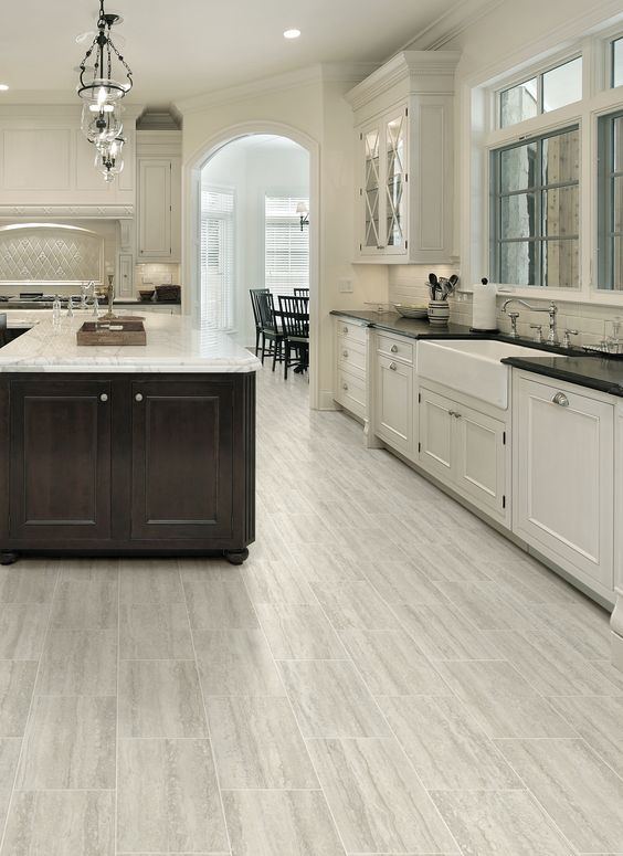 29 vinyl flooring ideas with pros and cons digsdigs for Vinyl kitchen flooring