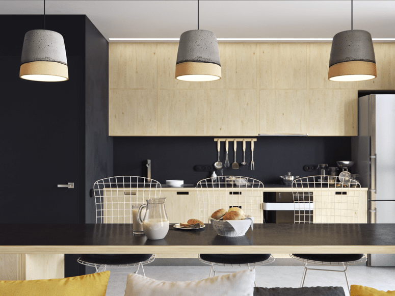 Light wood cabinets and furniture contrast with black in the kitchen