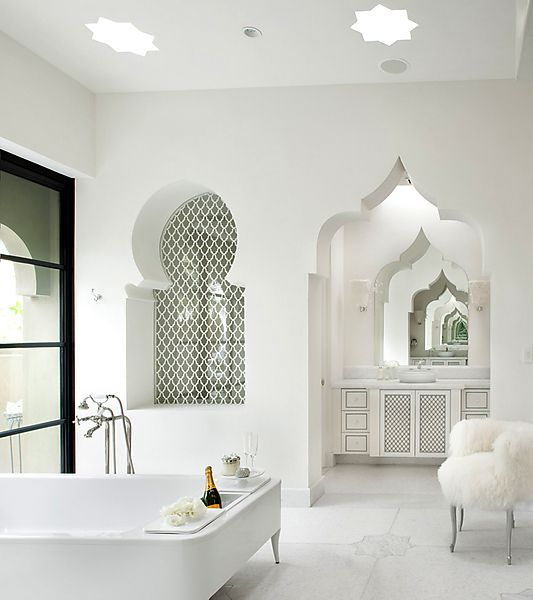 Moroccan style bathroom with an arch reflected in the mirror for creating an effect