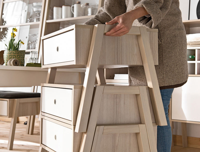 The furniture is modular, stackable and is made of blond wood