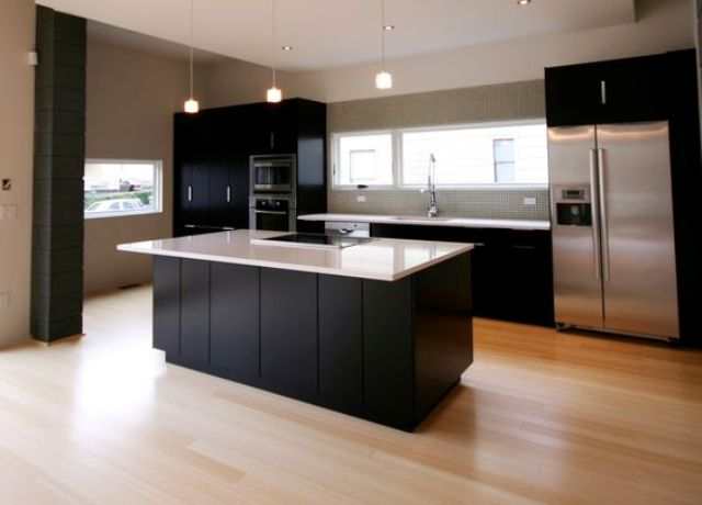 black and white ktichen with light bamboo floors for a softer look