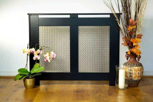 dark radiator cover and a plant stand in one