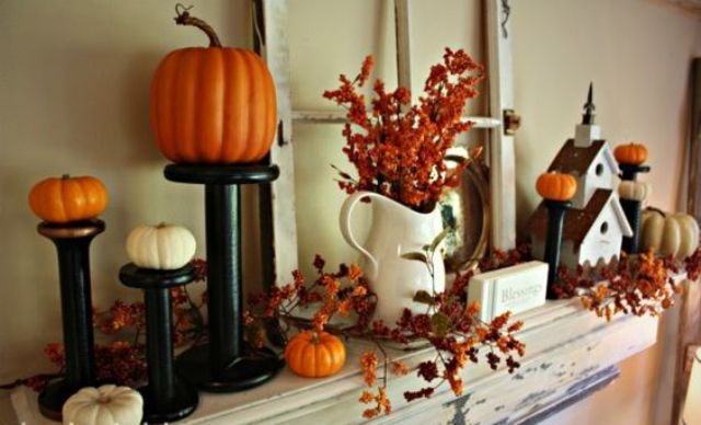 pumpkins on stands, faux leaves and a vintage window frame