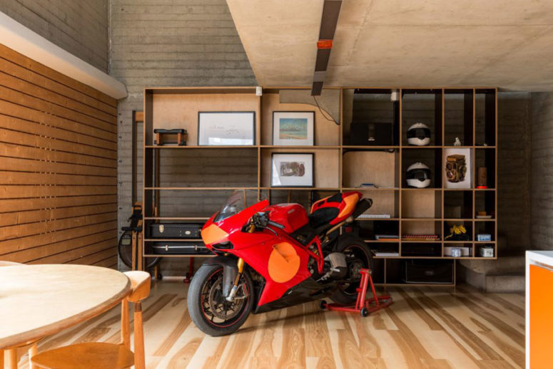 A red motorcycle is a part of the decor, though it's used sometimes. it adds a masculine touch to the interior
