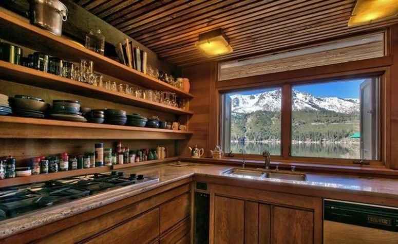 In the kitchen everything is covered and made of wood, and it also shows great views