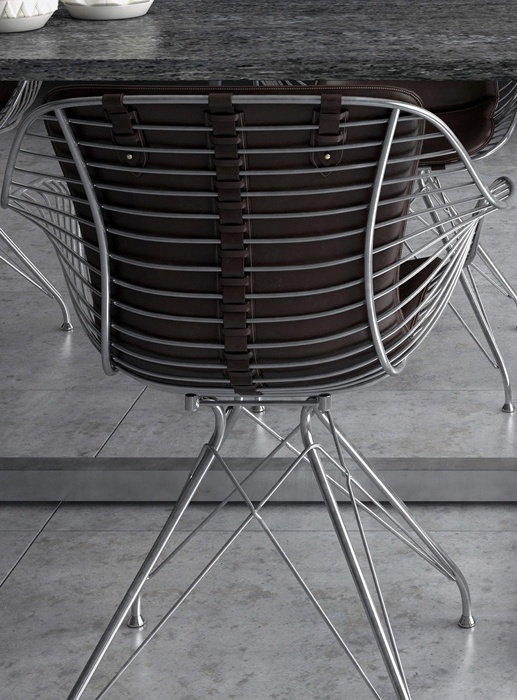 Metal grid chairs are covered with natural leather, which gives more masculinity to the space