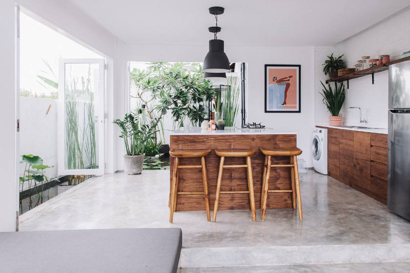 The open plan kitchen with a sunken lounge faces a beautiful Mexican garden