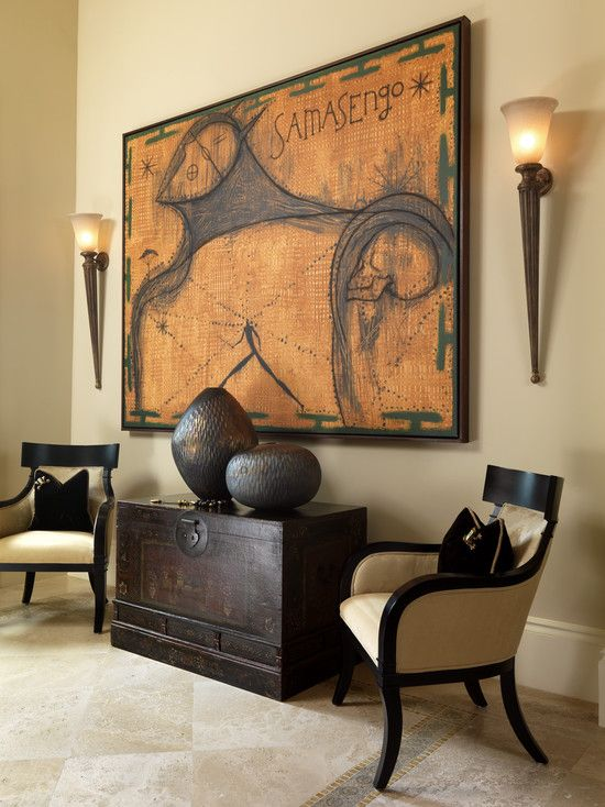 Warm colour palette and dark espresso furnishings and decor with 2 torch  wall sconces flanking a