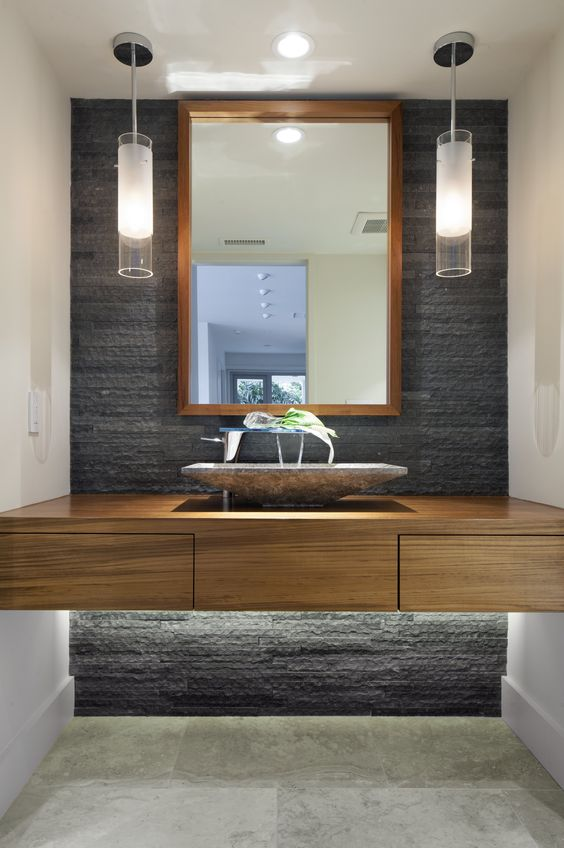 grey stone echoes with the sink and adds luxury
