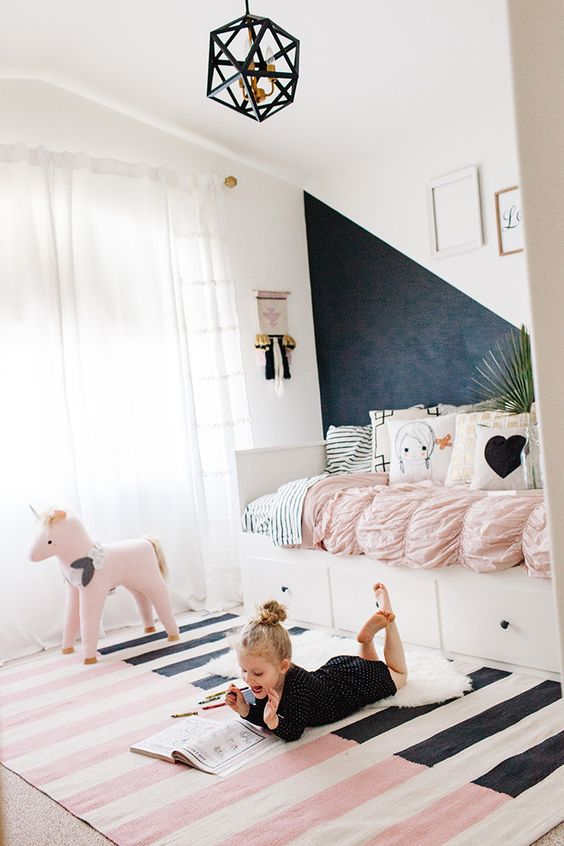 modern sleeping nook with a chalkboard wall for a creative kid