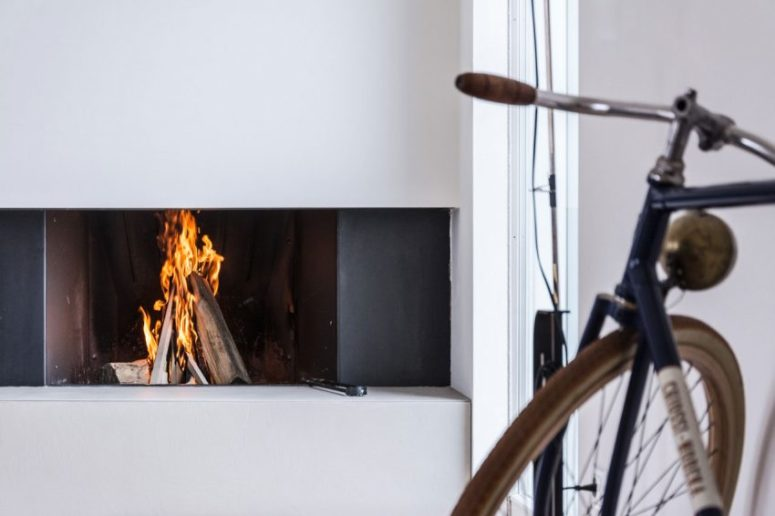 A modern built-in fireplace adds to the atmosphere and makes this clean space cozier