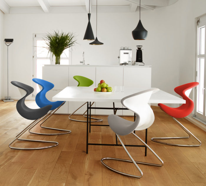 Another modern dining space is completed with Oyo chairs of various colors