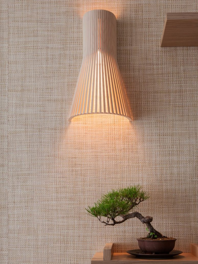 Even this lamp is made of wood and attached to the wall, it's so unusual