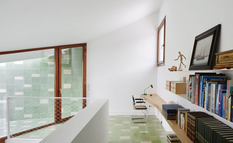 White walls are complemented by timber details, in window frames and doors