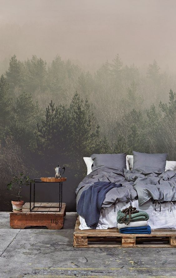 misty woodland photo mural adds a relaxing touch to the bedroom