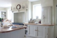 06 stone floors creates a modern feeling in this traditional kitchen