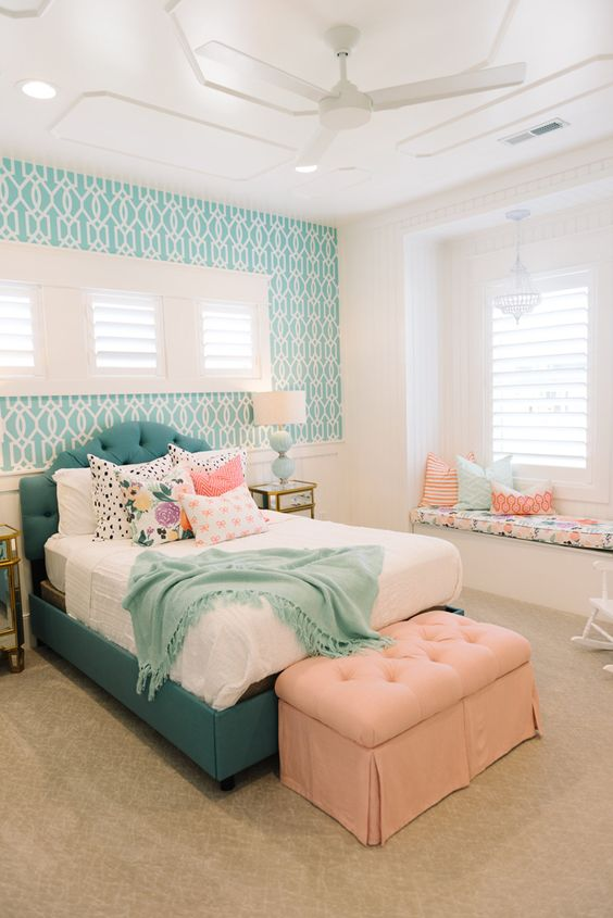 turquoise wallpaper highlights the bed look
