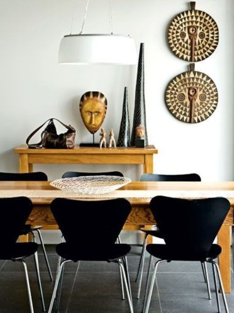 Chic Ethnic Dining Room Design With Ocher Colored Furniture And African Pottery