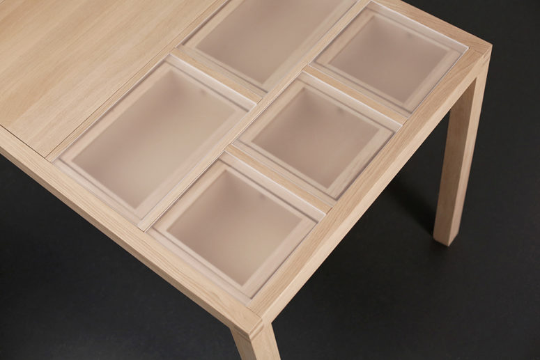 The central part of the table has a fixed surface, and materials can be stored on the left or right side