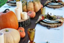 07 brown fabric table runner, natural pumpkins, candles on wood slices