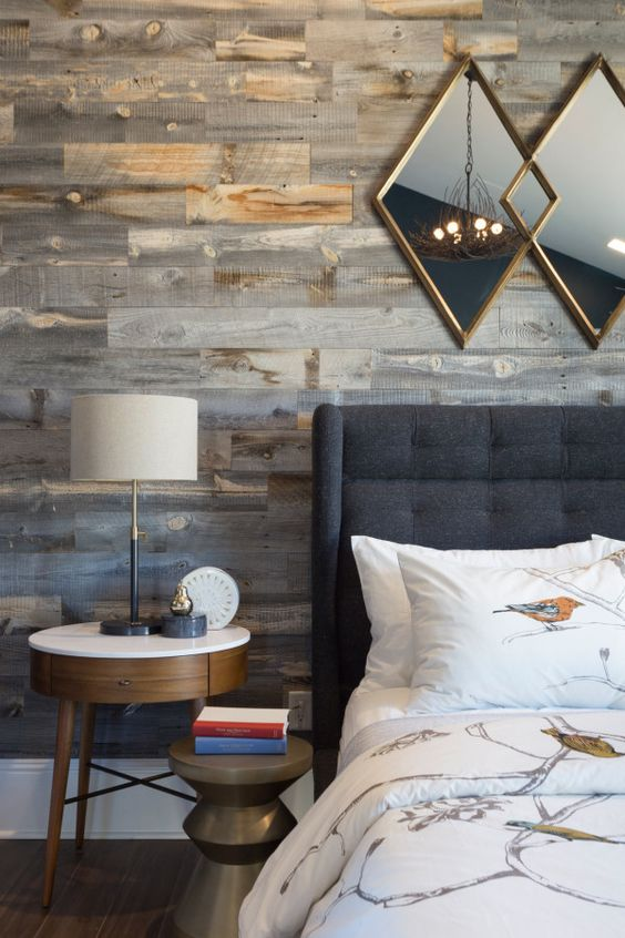 contemporary farmhouse bedroom with rustic wood-clad accent wall