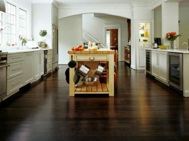 dark horizontal-grain bamboo floors lend drama and elegance in an open kitchen