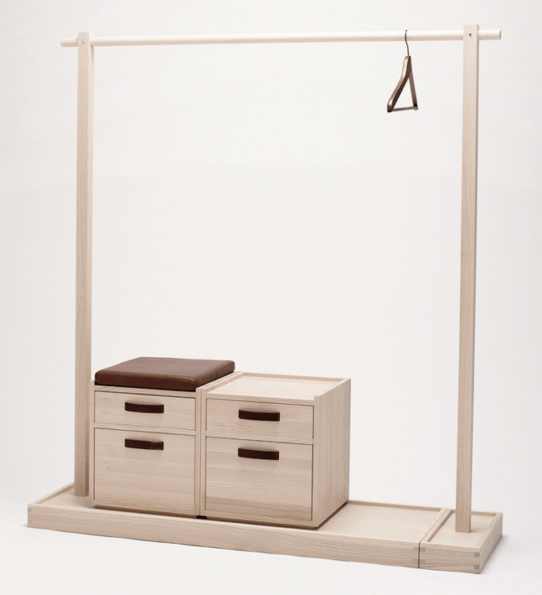 plywood clothes rack with a shoe stand and enclosed storage cabinets