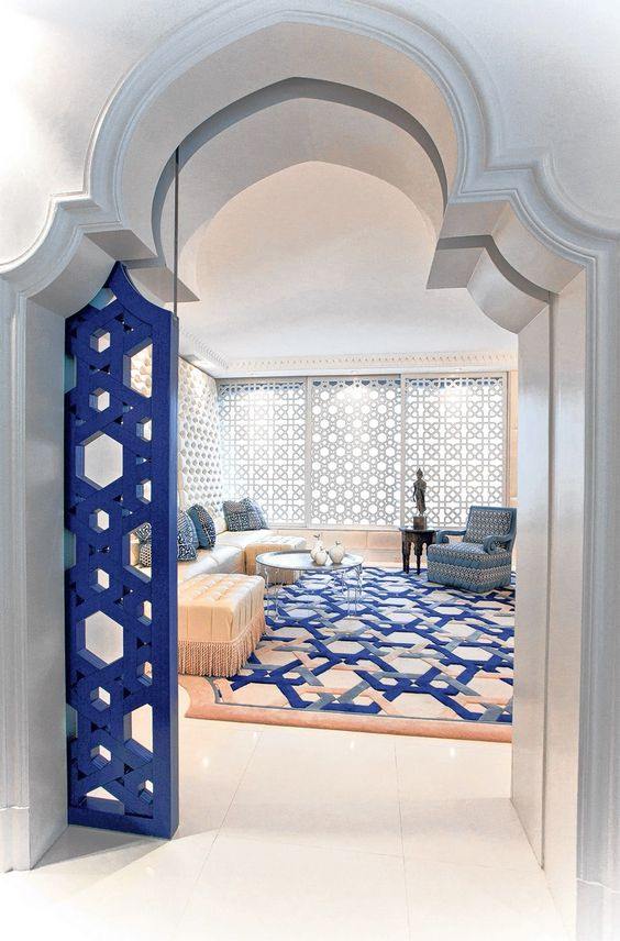 thick doorway with a Moroccan arch and blue styled door