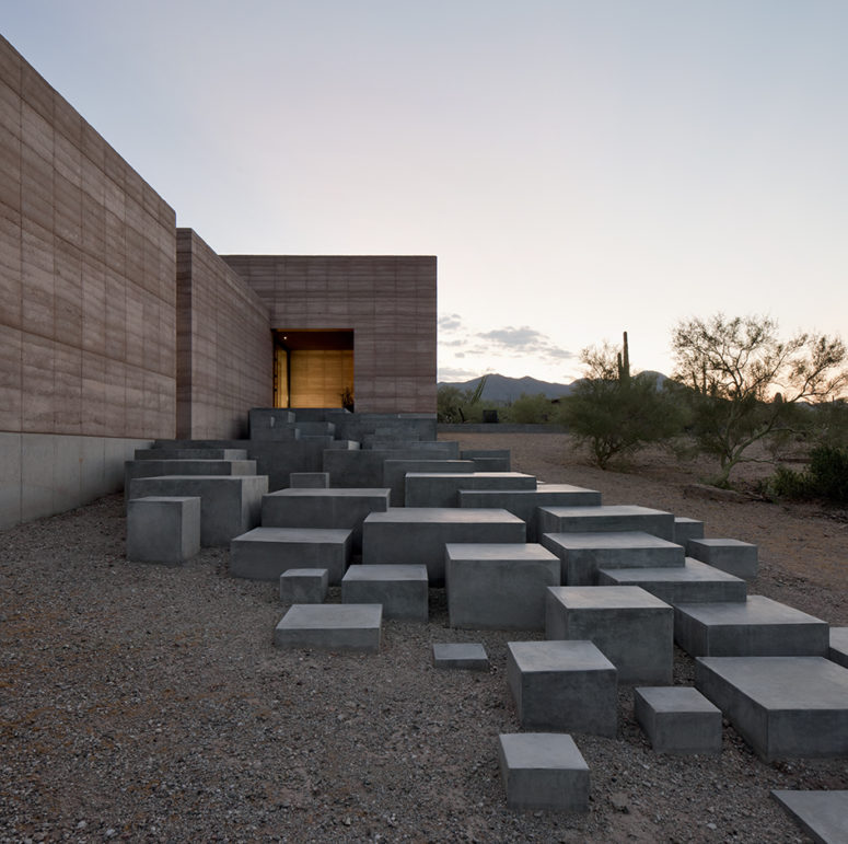 A series of sculptural concrete steps greets visitors and leads them to the main entrance